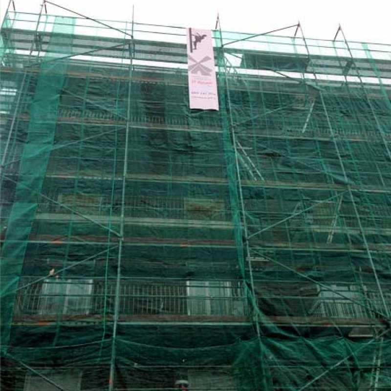Reparación completa en fachada de edificio